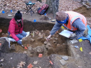 Excavating platform hearth at Venture Smith archaeological site